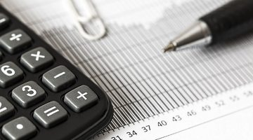 pen and calculator for tax preparation